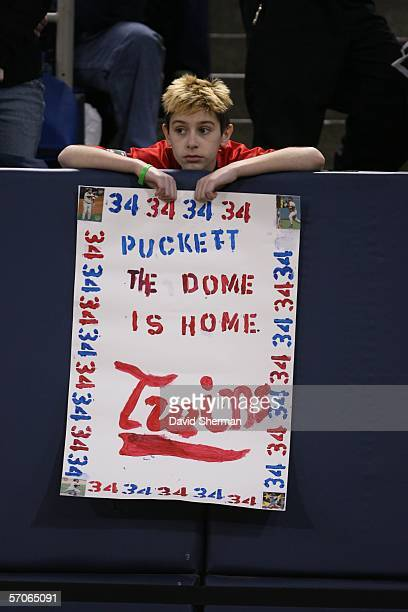A fan holds a sign at the public memorial service for Kirby Puckett at the Hubert H Humphrey Metrodome on March 12 2006 in Minneapolis Minnesota...