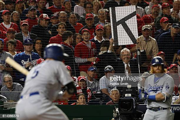 A fan holds a sign during game five of the National League Division Series between the Los Angeles Dodgers and the Washington Nationals at Nationals...
