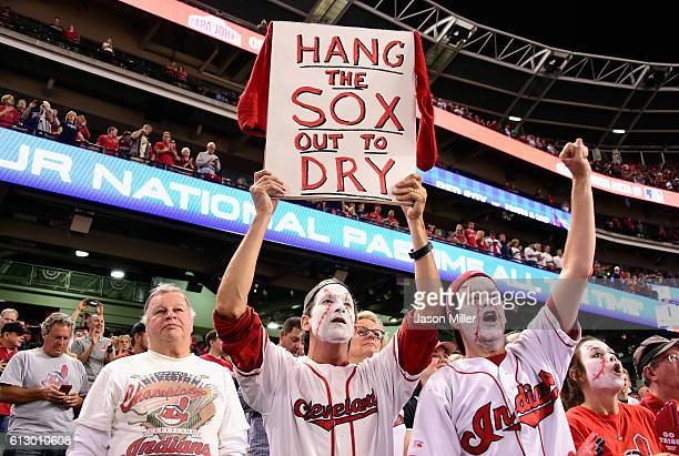 A fan holds a sign during game one of the American League Divison Series between the Boston Red Sox and the Cleveland Indians at Progressive Field on...