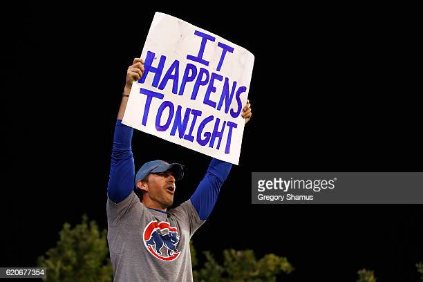 A fan holds a sign during Game Seven of the 2016 World Series between the Chicago Cubs and the Cleveland Indians at Progressive Field on November 2...