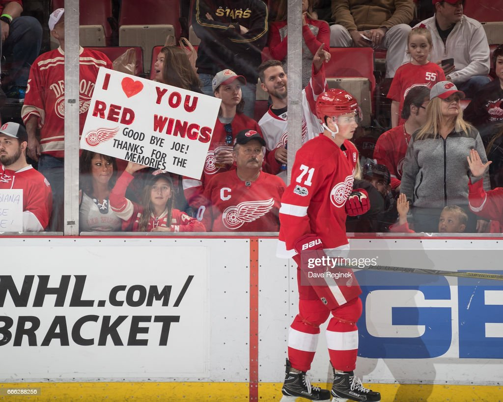 A fan holds a sign during warm-ups as Dylan Larkin #71 of the Detroit Red Wings skates around prior to an NHL game against the Montreal Canadiens at Joe Louis Arena on April 8, 2017 in Detroit, Michigan.