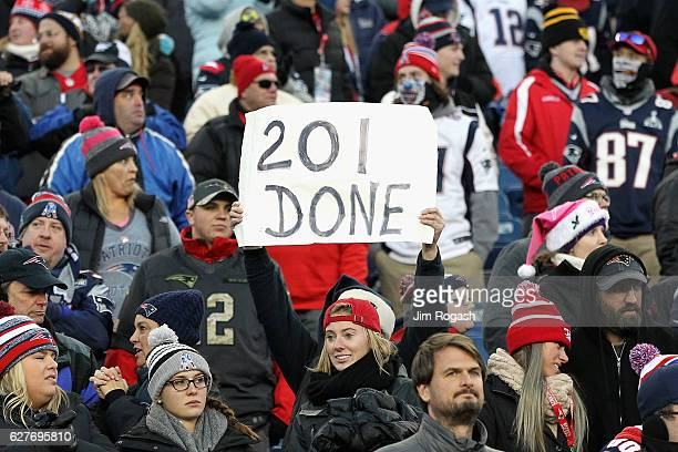 A fan holds a sign for Tom Brady of the New England Patriots during the game between the New England Patriots and the Los Angeles Rams at Gillette...