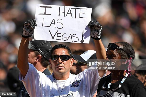 A fan holds a sign in the stands in reference to a potential move by the Oakland Raiders to Las Vegas during the NFL game between the Oakland Raiders...