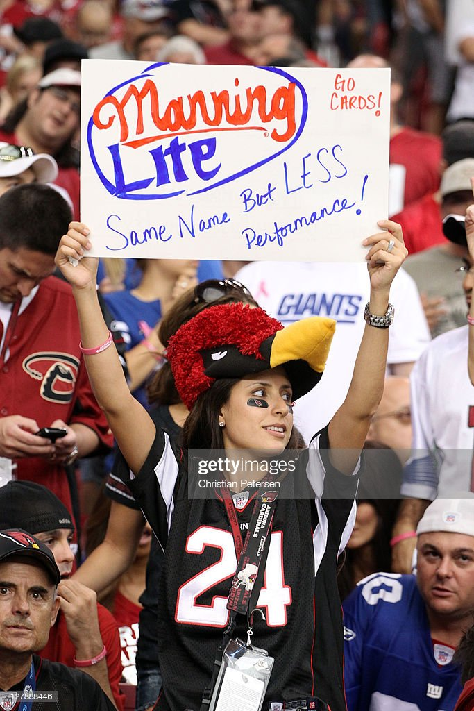 A Fan Holds A Sign Making Fun Of Eli Manning Of The New York