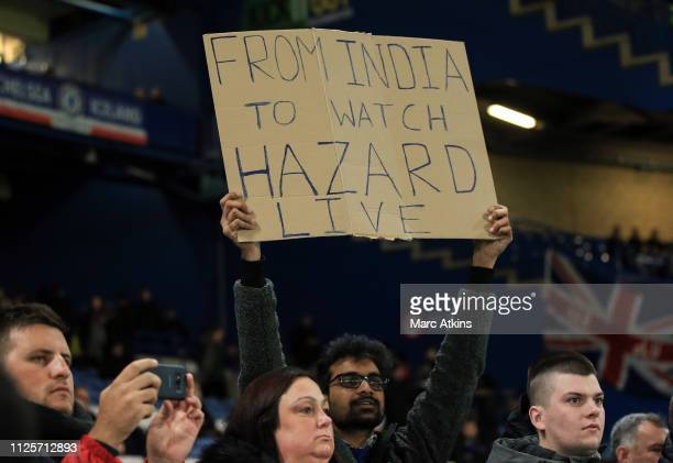 A fan holds a sign marking his long trip to Stamford Bridge to watch Eden Hazard during the FA Cup Fifth Round match between Chelsea and Manchester...