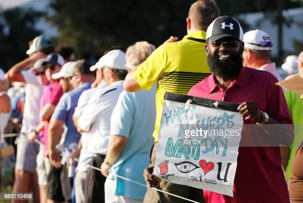A fan holds a sign on the course during the final round of THE PLAYERS Championship on THE PLAYERS Stadium Course at TPC Sawgrass on May 14 in Ponte...