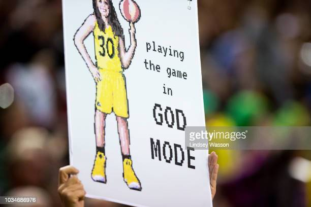 A fan holds a sign picturing Breanna Stewart of the Seattle Storm during the first half of Game 2 of the WNBA Finals at KeyArena on September 9 2018...