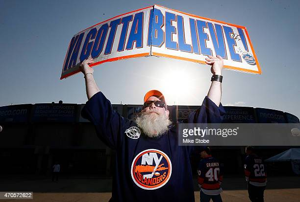 Fan holds a sign prior to the game between the New York Islanders and the Washington Capitals during Game Four of the Eastern Conference...