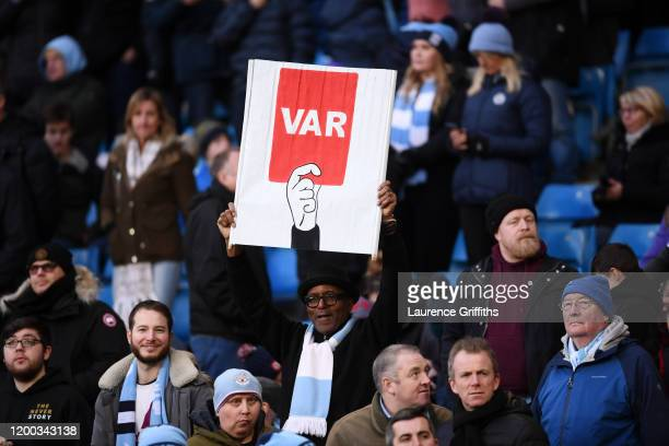 Fan holds a sign protesting against VAR during the Premier League match between Manchester City and Crystal Palace at Etihad Stadium on January 18,...