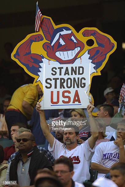 A fan holds a sign reading 'Stand Strong USA' prior to the start of a game between the Kansas City Royals and the Cleveland Indians on September 18...