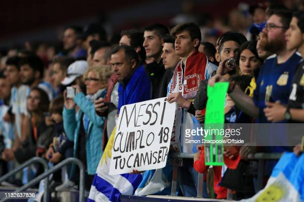 A fan holds a sign requesting the shirt of Lionel Messi of Argentina during the international friendly match between Argentina and Venezuela at...