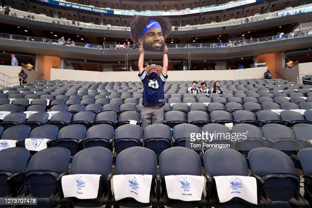 Fan holds a sign supporting Ezekiel Elliott of the Dallas Cowboys before the Dallas Cowboys take on the Atlanta Falcons at AT&T Stadium on September...