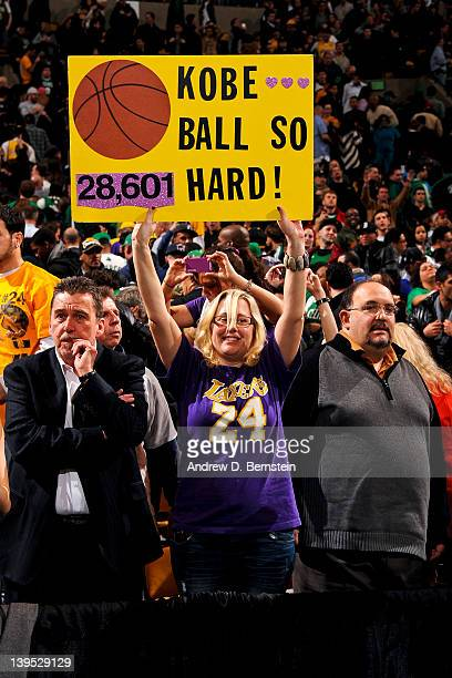 A fan holds a sign supporting Kobe Bryant of the Los Angeles Lakers after he reached the 28601 point milestone becoming 5th on the NBA AllTime...