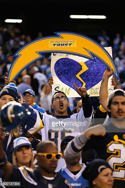 A fan holds a sign supporting the San Diego Chargers during a game against the Miami Dolphins at Qualcomm Stadium on December 20 2015 in San Diego...