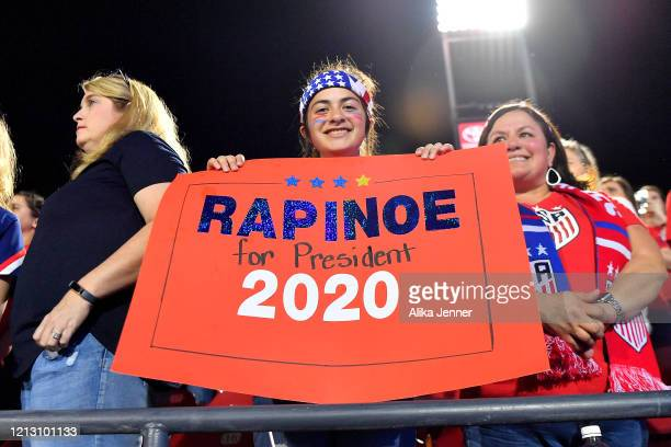 A fan holds a sign supporting the United States after the SheBelieves Cup match against Japan at Toyota Stadium on March 11 2020 in Frisco Texas The...