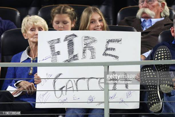 """Fan holds a sign that reads """"Fire Garrett"""" in the fourth quarter of a game between the Dallas Cowboys and the Buffalo Bills at AT&T Stadium on..."""