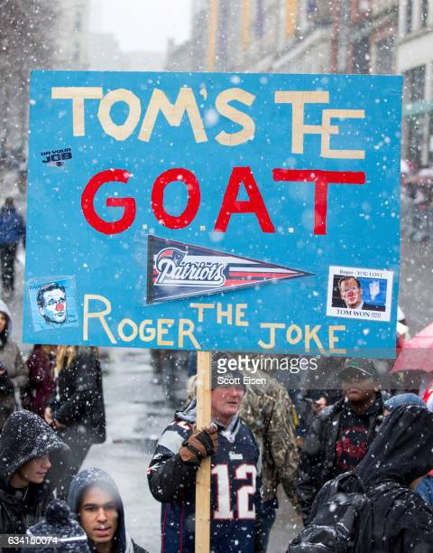 A fan holds a sign that reads 'Tom's the Goat Roger the Joke' during the New England Patriots victory parade on February 7 2017 in Boston...
