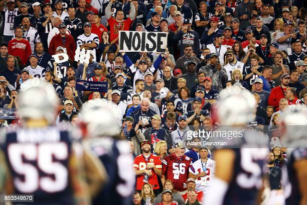 A fan holds a sign that says noise in the third quarter against the Kansas City Chiefs at Gillette Stadium on September 7 2017 in Foxboro...