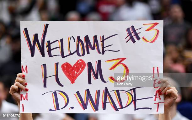 A fan holds a sign welcoming back Dwyane Wade of the Miami Heat during the game against the Milwaukee Bucks at American Airlines Arena on February 9...