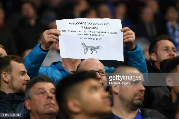 A fan holds a sign welcoming new Leicester City manager Brendan Rodgers during the Premier League match between Leicester City and Brighton Hove...