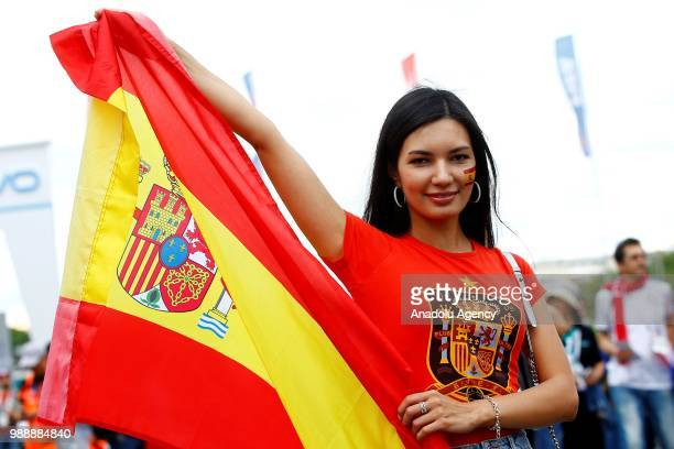 A fan holds a Spanish flag ahead of the 2018 FIFA World Cup Russia Round of 16 match between Spain and Russia at the Luzhniki Stadium in Moscow...