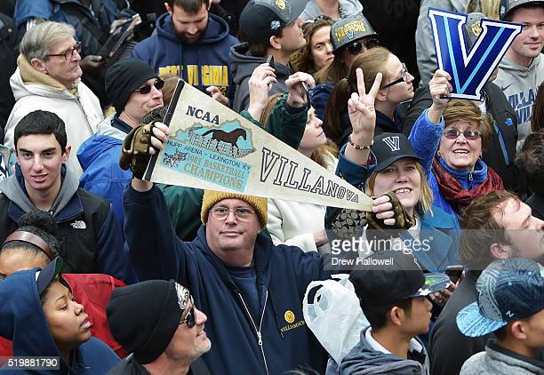 A fan holds a tenant from the last championship in 1985 during the Villanova Wildcats Championship Parade on April 8 2016 in Philadelphia Pennsylvania