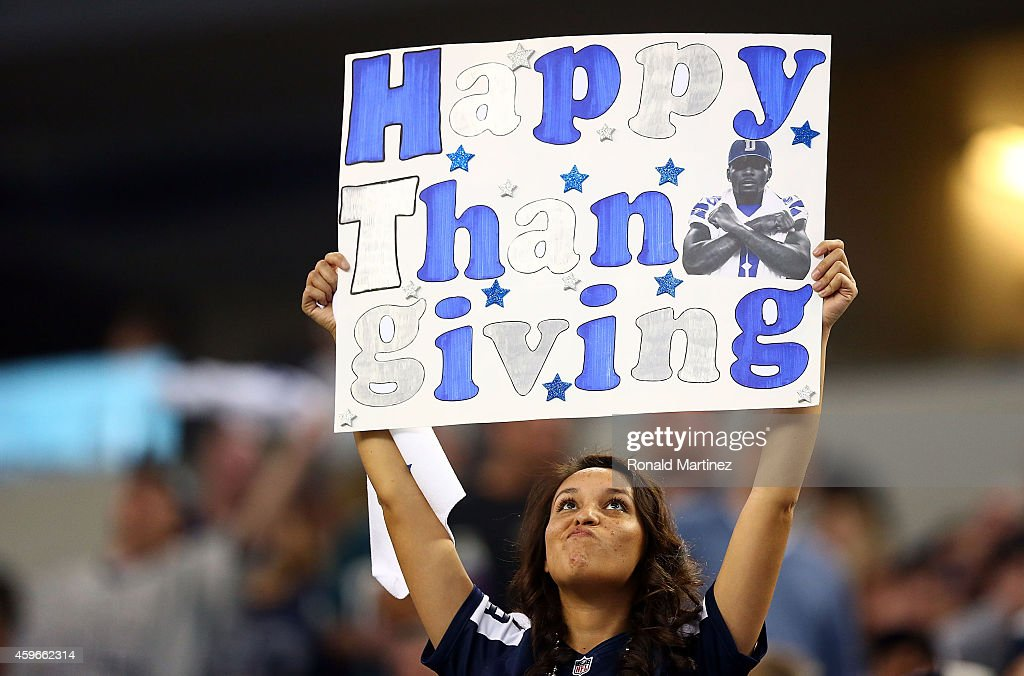 A fan holds a Thanksgiving Day sign during the game between the Philadelphia Eagles and the Dallas Cowboys at AT&T Stadium on November 27, 2014 in Arlington, Texas.