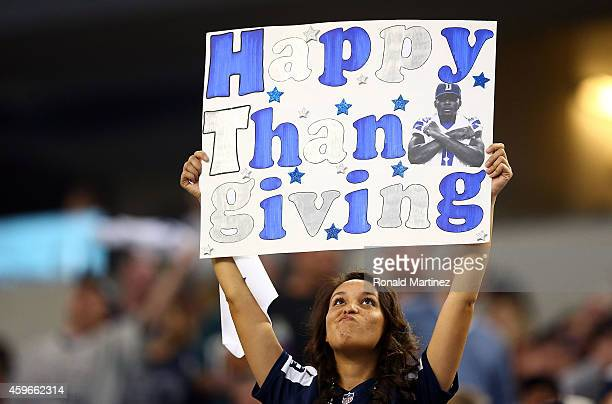 A fan holds a Thanksgiving Day sign during the game between the Philadelphia Eagles and the Dallas Cowboys at ATT Stadium on November 27 2014 in...