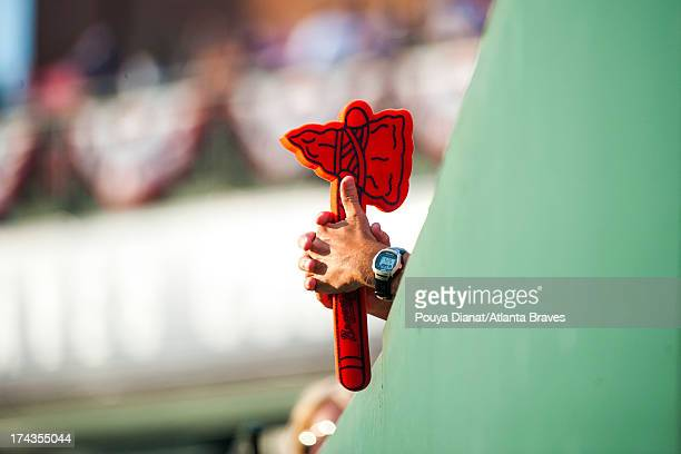 A fan holds a Tomahawk during the game against the Miami Marlins at Turner Field on July 2 2013 in Atlanta Georgia The Braves won 113