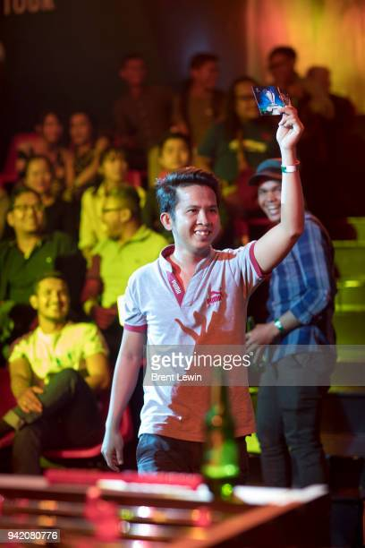 A fan holds a winning ticket for a draw during the UEFA Champions League Trophy Tour presented by Heineken on April 4 2018 in Phnom Penh Cambodia