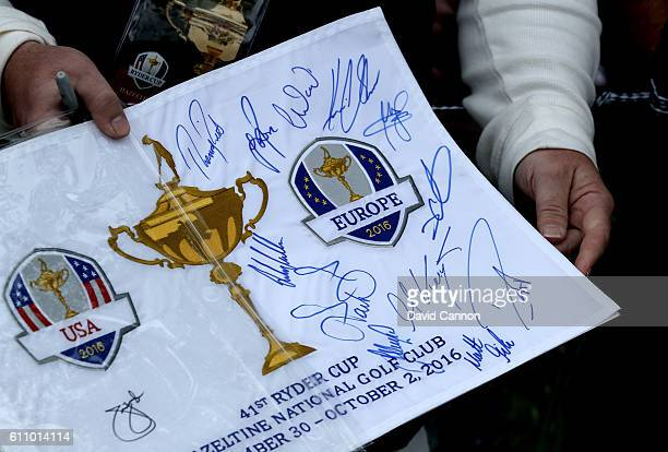 A fan holds an autographed flag during practice prior to the 2016 Ryder Cup at Hazeltine National Golf Club on September 28 2016 in Chaska Minnesota