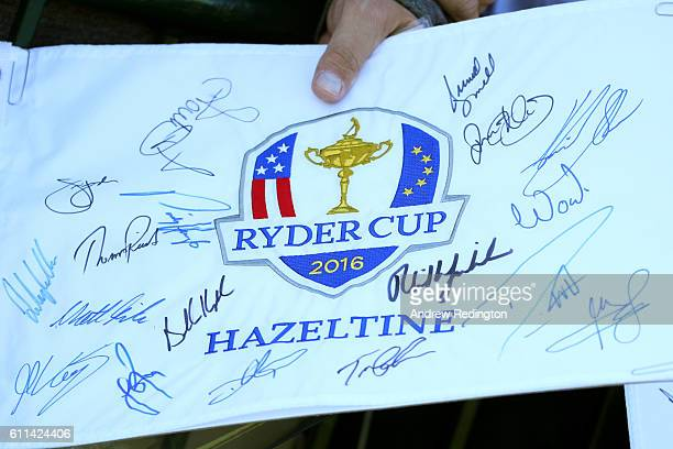 A fan holds an autographed flag during practice prior to the 2016 Ryder Cup at Hazeltine National Golf Club on September 29 2016 in Chaska Minnesota