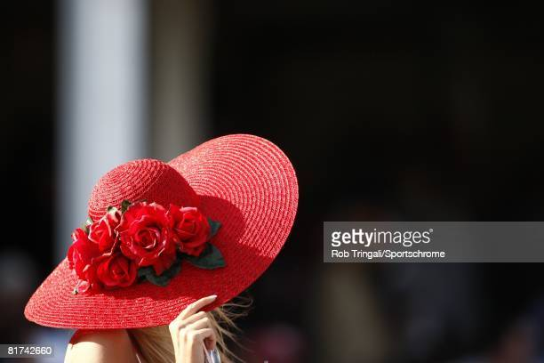 A fan holds her red hat during the 134th running of the Kentucky Derby at Churchill Downs on May 3 2008 in Louisville Kentucky