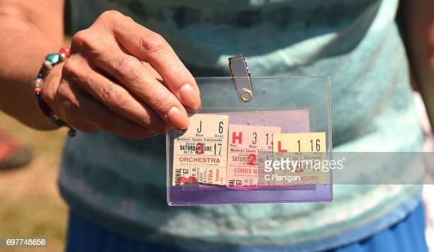 A fan holds up 3 of the original day tickets to the 1967 Montery Pop Festival during the 2017 Monterey International Pop Festival at Monterey County...