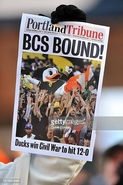 A fan holds up a copy of a mock front page after game between the Oregon Ducks and the Oregon State Beavers at Reser Stadium on December 4 2010 in...