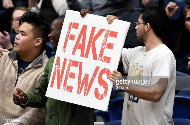 Fan holds up a Fake News sign during the game between the George Washington Colonials and the George Mason Patriots at Charles E. Smith Athletic...