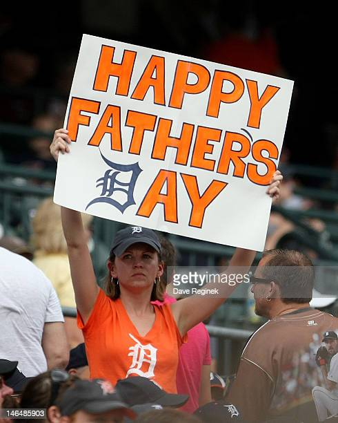 A fan holds up a 'Father's Day' sign during a MLB interleague game between the Detroit Tigers and the Colorado Rockies at Comerica Park on June 17...