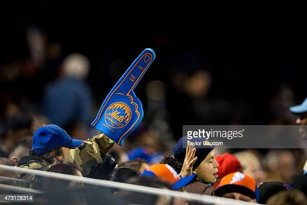 A fan holds up a foam finger during the game between the Washington Nationals and New York Mets at Citi Field on Friday May 1 2015 in the Queens...