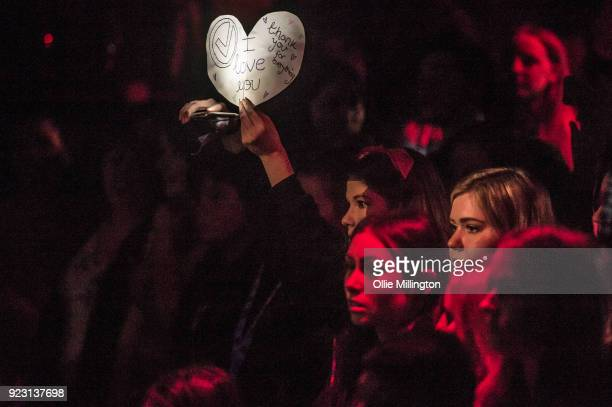 A fan holds up a hand written sign that reads thank you for everything I love you with the band's logo as The Vamps perform at Dingwalls on February...