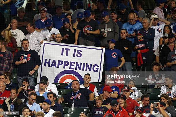 A fan holds up a It is Happening sign during Game 6 of the 2016 World Series between the Chicago Cubs and the Cleveland Indians at Progressive Field...