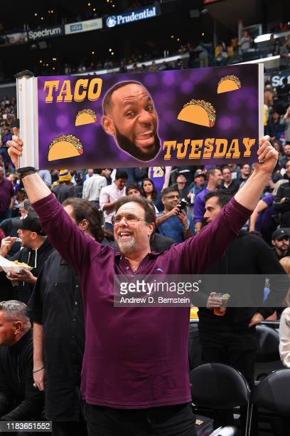 A fan holds up a LeBron James Taco Tuesday sign during the Los Angeles Lakers game against the Oklahoma City Thunder on November 19 2019 at STAPLES...