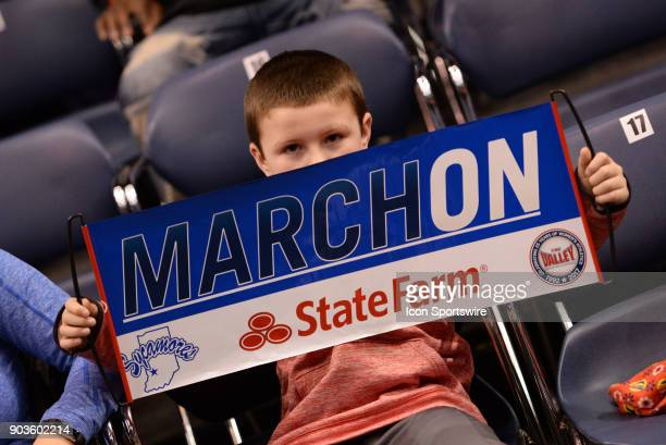 A fan holds up a 'March On' sign during the Missouri Valley Conference college basketball game between the Northern Iowa Panthers and the Indiana...