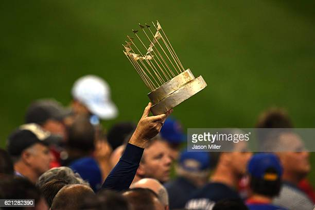 A fan holds up a mock trophy during Game Seven of the 2016 World Series between the Chicago Cubs and the Cleveland Indians at Progressive Field on...