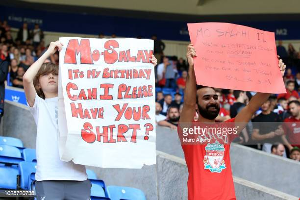 A fan holds up a Mohamed Salah of Liverpool shirt request sign during the Premier League match between Leicester City and Liverpool FC at The King...