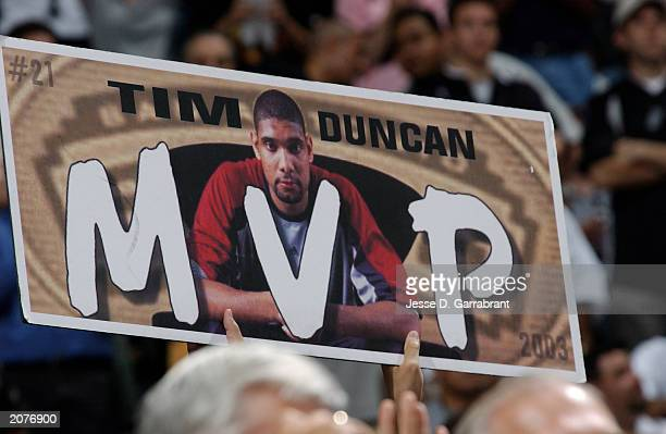 Fan holds up a MVP sign of Tim Duncan of the San Antonio Spurs in Game one of the 2003 NBA Finals against the New Jersey Nets at SBC Center on June 4...