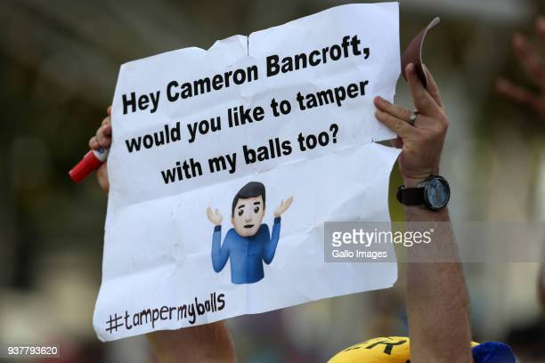 A fan holds up a poster during day 4 of the 3rd Sunfoil Test match between South Africa and Australia at PPC Newlands on March 25 2018 in Cape Town...