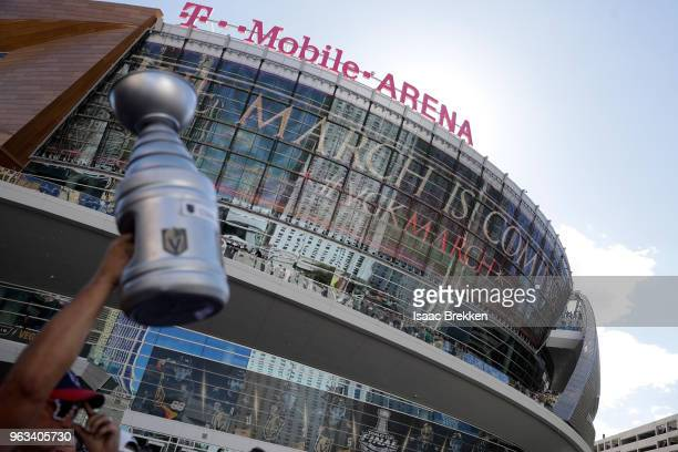 Fan holds up a replica Stanley Cup outside the arena prior to Game One of the 2018 NHL Stanley Cup Final between the Vegas Golden Knights and the...