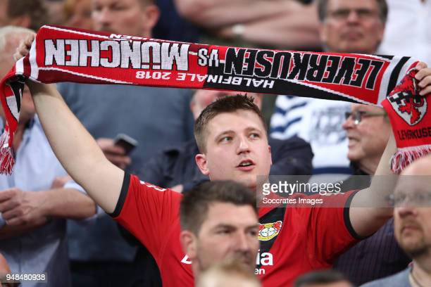 A fan holds up a scarf during the DFB Cup semi final match between Bayer 04 Leverkusen and Bayern Muenchen at BayArena on April 17 2018 in Leverkusen...