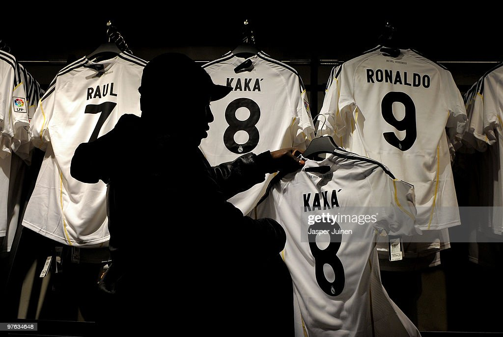 A fan holds up a shirt of Real Madrid player Kaka backdropped by shirts of other Real Madrid star players on the day after Real Madrid's UEFA Champions League aggregate defeat against Lyon at the Estadio Santiago Bernabeu on March 11, 2010 in Madrid, Spain.