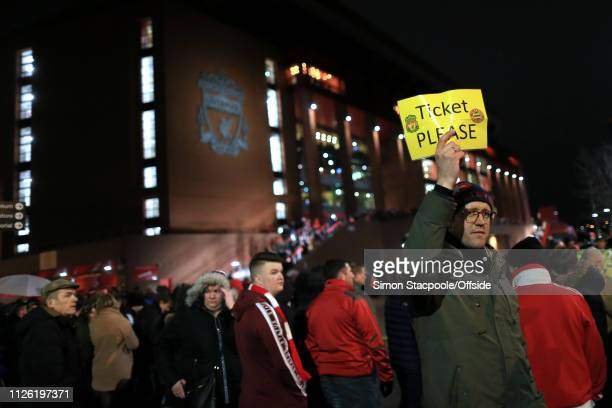 Fan holds up a sign asking for a spare ticket ahead of the UEFA Champions League Round of 16 First Leg match between Liverpool and FC Bayern Muenchen...